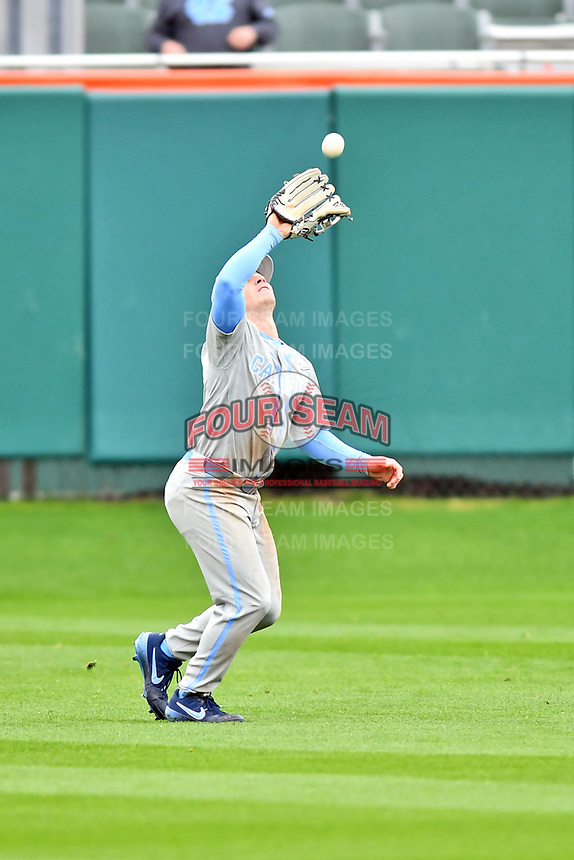 North Carolina Tar Heels center fielder Dylan Harris (3) fields a fly ball during a game against the Clemson Tigers at Doug Kingsmore Stadium on March 9, 2019 in Clemson, South Carolina. The Tigers defeated the Tar Heels 3-2 in game one of a double header. (Tony Farlow/Four Seam Images)