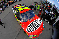 Jeff Gordon (#24) exits his garage.
