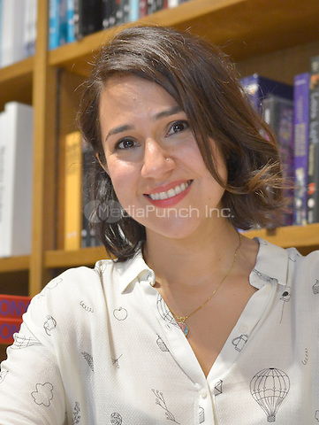 "CORAL GABLES, FL - JUNE 09: Author Luz Ortiz signs copies of her new book "" Luzia '' at Books and Books on June 9, 2016 in Coral Gables, Florida.  Credit: MPI10 / MediaPunch"