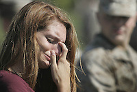 Natalie Harris cries as she watches her boyfriend, Lance Cpl. James McCratic of the 1st Battalion 8th Marines from Camp Lejeune, Jacksonville, N.C., load onto buses for deployment to Afghanistan Friday morning.