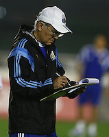 Argentina coach Alejandro Sabella makes notes on a tactics board