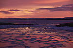 Sunset over a frozen Wager Bay in Nunavut, Canada.