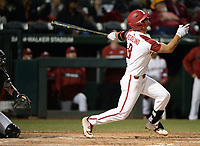 NWA Democrat-Gazette/ANDY SHUPE<br /> Arkansas first baseman Jordan McFarland connects for a bases-loaded sacrifice fly against Western Illinois Tuesday, March 12, 2019, during the fourth inning at Baum-Walker Stadium in Fayetteville. Visit nwadg.com/photos to see more photographs from the game.