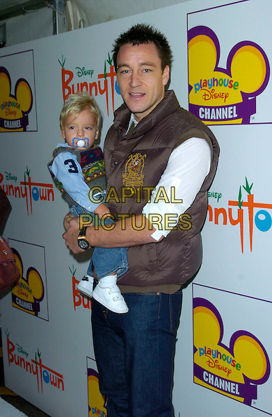 JOHN TERRY & SON.At The Playhouse Disney Celebrity Christmas Party, Covent Garden Film Studios, London, England, December 2nd 2007..half length brown body warmer child blue dummy.CAP/CAN.©Can Nguyen/Capital Pictures