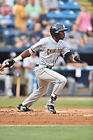 Charleston RiverDogs left fielder Estevan Florial (8) swings at a pitch during a game against the Asheville Tourists at McCormick Field on July 6, 2017 in Asheville, North Carolina. The Tourists defeated the RiverDogs 13-9. (Tony Farlow/Four Seam Images)