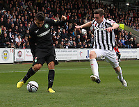 Anthony Watt crosses before the tackle from Paul Dummett in the St Mirren v Celtic Clydesdale Bank Scottish Premier League match played at St Mirren Park, Paisley on 20.10.12.