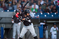 Salem-Keizer Volcanoes left fielder Diego Rincones (19) at bat during a Northwest League game against the Hillsboro Hops at Ron Tonkin Field on September 1, 2018 in Hillsboro, Oregon. The Salem-Keizer Volcanoes defeated the Hillsboro Hops by a score of 3-1. (Zachary Lucy/Four Seam Images)