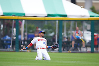 Buffalo Bisons outfielder Dalton Pompey (37) makes a sliding catch during a game against the Columbus Clippers on July 19, 2015 at Coca-Cola Field in Buffalo, New York.  Buffalo defeated Columbus 4-3 in twelve innings.  (Mike Janes/Four Seam Images)