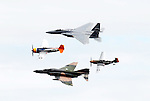Clockwise from top: A modern era F-15, a WWII era P-51, a Vietnam era F-4 and a WWII era P-47 fly at the Wings Over Houston Air Show Sunday Oct. 22,2006.