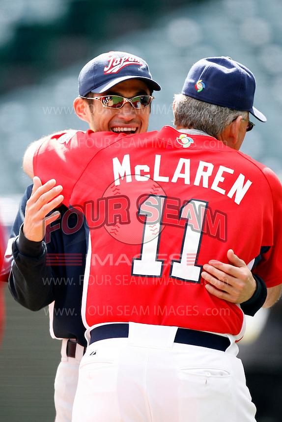 Ichiro Suzuki of Japan and John McLaren of the USA during World Baseball Championship at Angel Stadium in Anaheim,California on March 12, 2006. Photo by Larry Goren/Four Seam Images