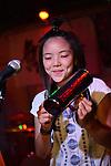 Kaohsiung, Taiwan -- Alicia Lin of LA CUMBIA DEL SOL performing at the Paramount Bar on July 06, 2014.