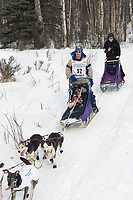 Hugh Neff w/Iditarider on Trail 2005 Iditarod Ceremonial Start near Campbell Airstrip Alaska SC