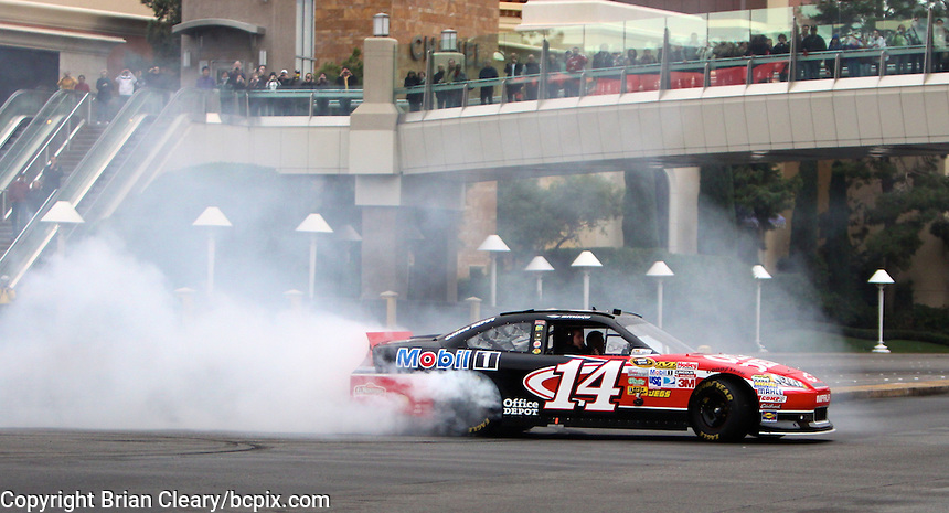 NASCAR champion Tony Stewart performs a victory burnout on Las Vegas Blvd during 2001 NASCAR champion's week, Las Vegas, NV December 1, 2011.  (Photo by Brian Cleary/www.bcpix.com)