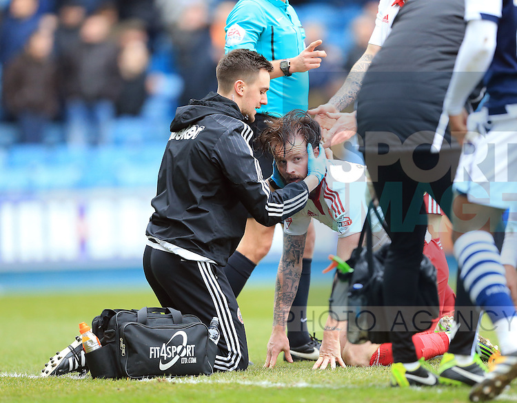 Sheffield United's Chris Brayford looks on after a clash of heads during the League One match at The Den.  Photo credit should read: David Klein/Sportimage