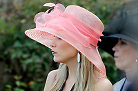 HOT SPRINGS, AR - MARCH 18: A woman wears a derby hat before the running of the Rebel Stakes at Oaklawn Park on March 18, 2017 in Hot Springs, Arkansas. (Photo by Justin Manning/Eclipse Sportswire/Getty Images)