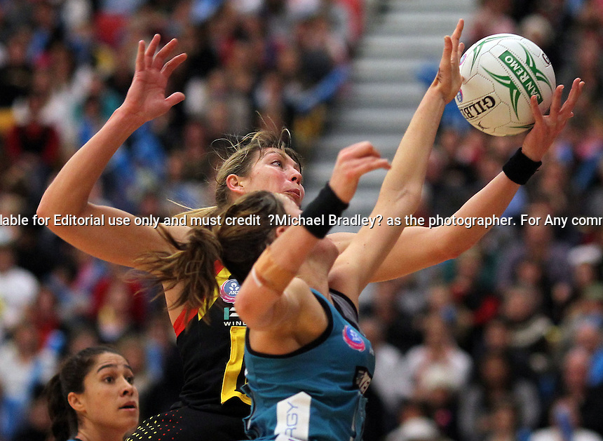 19.06.2010 Magic's Irene Van Dyk and Thunderbirds Sharni Layton in action during the ANZ Champs netball match between the Magic and Thunderbirds played at Rotorua Energy Centre in Rotorua ©MBPHOTO/Michael Bradley