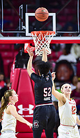 College Park, MD - NOV 13, 2017: South Carolina Gamecocks guard Tyasha Harris (52) shoots a three point basket over Maryland Terrapins guard Kristen Confroy (12) and Terrapins guard Sarah Myers (21) during game between No. 4 ranked South Carolina and the No. 15 Maryland Terrapins at the XFINITY Center in College Park, MD. The Gamecocks defeated Maryland 94-86.  (Photo by Phil Peters/Media Images International)