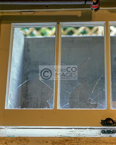 BROKEN FRAME OF OPEN BASEMENT WINDOW