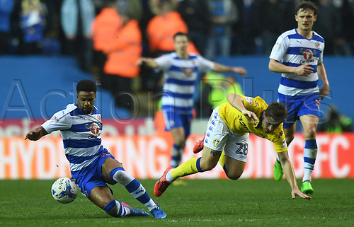 April 1st 2017, Madejski Stadium, Reading, Berkshire, England; Skybet Championship football, Reading Town versus Leeds United; Gaetano Berardi, Defender for Leeds United FC tackles Garath McCleary, Midfielder for Reading FC