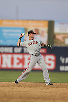 Christian Arroyo (2) of the San Jose Giants makes a throw during a game against the Lancaster JetHawks at The Hanger on April 11, 2015 in Lancaster, California. San Jose defeated Lancaster, 8-3. (Larry Goren/Four Seam Images)