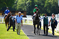 Winner of The Toby Balding Memorial Novice Stakes (Plus 10),Nyaleti ridden by John Egan and trained by Mark Johnston  are led into the winners enclosureduring Father's Day Racing at Salisbury Racecourse on 18th June 2017