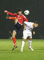 Levon Ananyan (7) and Florian Gudit challenge in the Armenia v Switzerland UEFA European Under-19 Championship Qualifying Round match at New Douglas Park, Hamilton on 11.10.12.