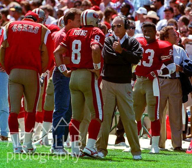 San Francisco 49ers vs. San Diego Chargers at Candlestick Park Sunday, September 8, 1991.  49ers beat Chargers 34-14.  Head coach George Seifert talks to Steve Young on sidelines.