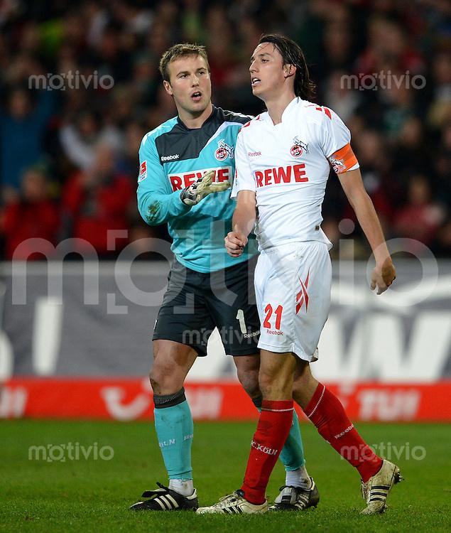 FUSSBALL   1. BUNDESLIGA   SAISON 2011/2012   26. SPIELTAG Hannover 96 - 1. FC Koeln              18.03.2012 Torwart Michael Rensing (li) und Pedro Geromel (re, beide 1. FC Koeln) sind enttaeuscht