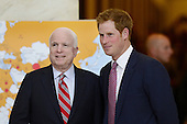Prince Harry (R) of Wales tours a HALO Trust photo exhibit on landmines and unexploded ordinances, with Republican Senator from Arizona John McCain (L), on Capitol Hill in Washington DC, USA, 09 May 2013. Prince Harry begins a six-day tour of the United States..Credit: Michael Reynolds / Pool via CNP
