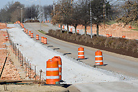 NWA Democrat-Gazette/DAVID GOTTSCHALK Road work continues Friday, March 22, 2019, on Watkins Avenue near the intersection of Gene George Boulevard in Springdale. Street projects  will continue in Springdale including the area 56th Street and Gene George Boulevard with 2018 bond money.