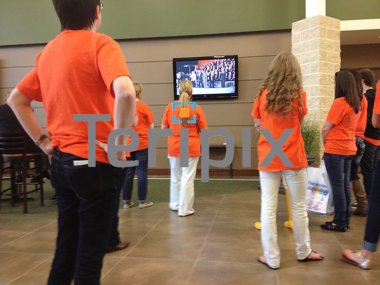 3/31/13 Members watch praise & worship in the foyer during the first service in Prosper.