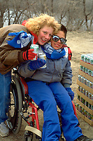 Mom hugging foster son age 14 and 25 in wheelchair at MS WalkAThon.  St Paul Minnesota USA