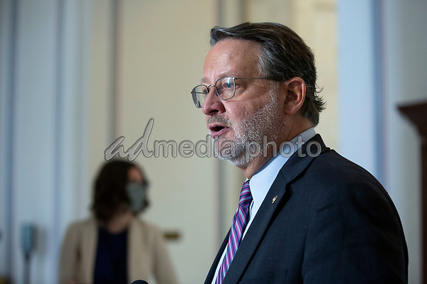United States Senator Gary Peters (Democrat of Michigan) speaks to members of the media following a U.S. Senate Committee on Homeland Security and Governmental Affairs meeting in the Senate Russell Office Building in Washington D.C., U.S., on Wednesday, May 20, 2020, to consider a motion to issue a subpoena to Blue Star Strategies.  Credit: Stefani Reynolds / CNP/AdMedia