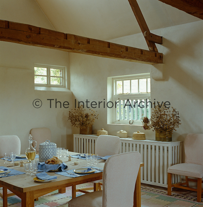 Lunch is often served at the large wooden table in the kitchen that seats twelve