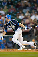 Blair Dunlap #9 of the UCLA Bruins follows through on his swing versus the Baylor Bears in the 2009 Houston College Classic at Minute Maid Park February 28, 2009 in Houston, TX.  The Bears defeated the Bruins 5-1. (Photo by Brian Westerholt / Four Seam Images)