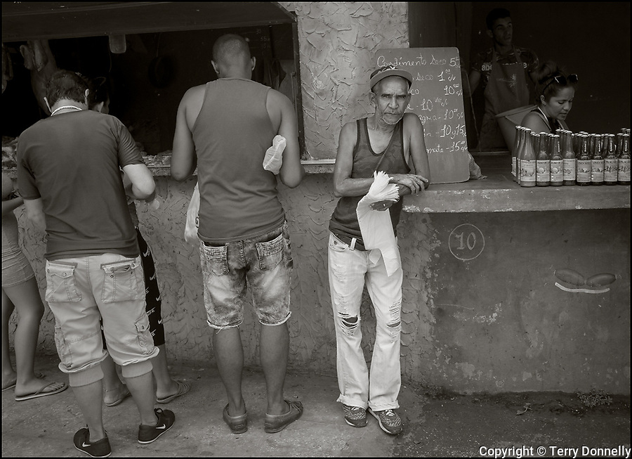 Regla, Havana, Cuba:<br /> Street scene and vendor in the Regla nieghborhood