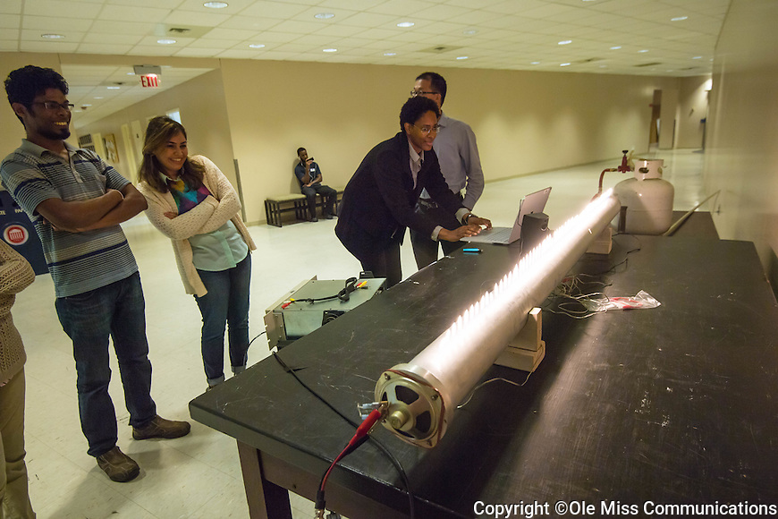 Visitors see sound waves in flame at the open house and demonstrations at the 30th anniversary celebration at NCPA. Photo by Kevin Bain/Ole Miss Communications