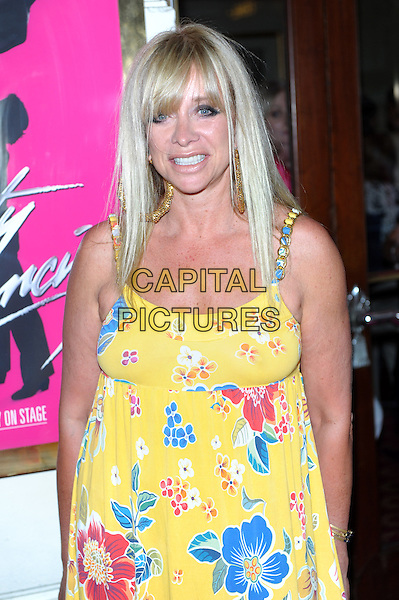 Jo Wood<br /> &quot;Dirty Dancing The Classic Story on Stage&quot; at the Piccadilly Theatre, London, England.<br /> 17th July 2013<br /> half length red blue yellow dress floral print <br /> CAP/CJ<br /> &copy;Chris Joseph/Capital Pictures