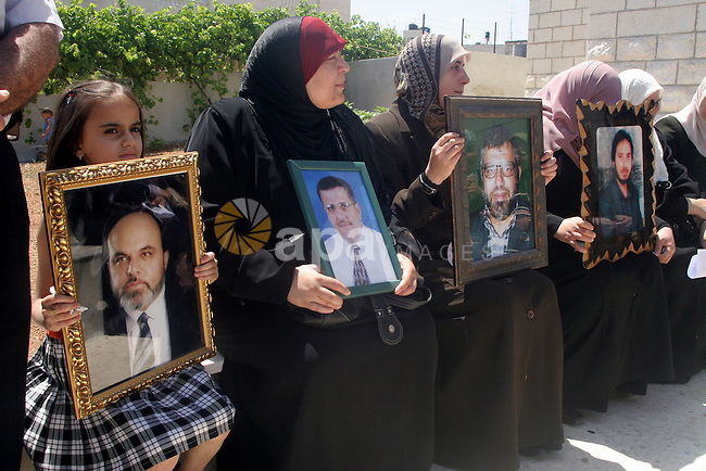 Palestinian relatives of  Hamas Members Holding Portraits for there jailed relatives in Israeli Prisons during a protest in front International Red Crescent Office in the west bank city of Ramallah.