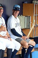 Charlotte Stone Crabs pitching coach Steve Watson (18) sits in the dugout with no pants after giving them to Braxton Lee (not shown) after ripping them while sliding during a game against the Daytona Tortugas on April 14, 2015 at Charlotte Sports Park in Port Charlotte, Florida.  Charlotte defeated Daytona 2-0.  (Mike Janes/Four Seam Images)