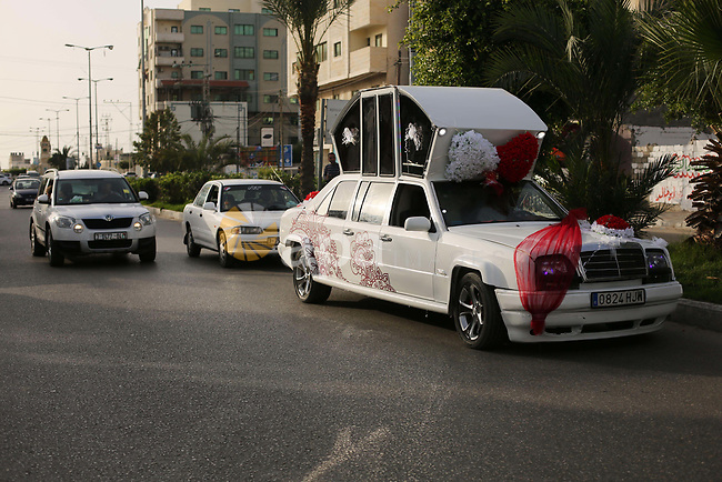 """A Palestinian mechanic display his """"Cinderella"""" vehicle in Gaza City on April 22, 2017. Made up of five different cars, it will be rented out for use at marriage ceremonies. Photo by Ashraf Amra"""