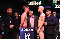 Mickey Burke (L) and Michael Williams during a Weigh In at the BT Studios, Queen Elizabeth Olympic Park on 12th July 2019