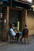 A couple smoking cigarette outside the Kala Ghoda cafe in Kala Ghoda in Mumbai, India. Photo: Sanjit Das/Panos