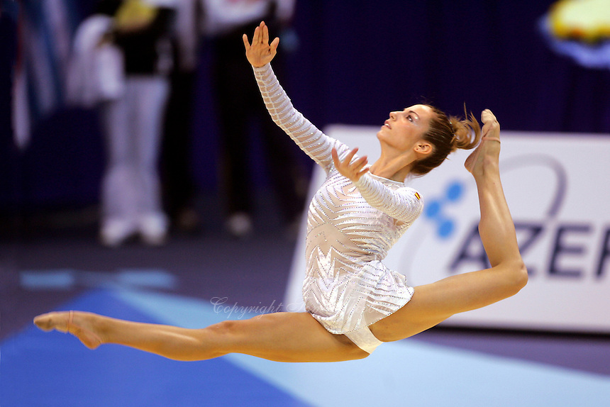 Almudena Cid of Spain split leaps to re-catch ball during All-Around final at World Championships at Baku, Azerbaijan on October 8, 2005. (Photo by Tom Theobald)