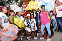 Members of the Baby Doll Sisterhood second line in memory of Baby Doll Tee Eva Perry, who died at 83 on June 7, in New Orleans, La. Monday, June 11, 2018. <br /> <br /> Members of the Baby Dolls Sisterhood dance for Baby Doll Tee Eva Perry, who died at 83 on June 7, in front of Tee-Eva's Authentic New Orleans Pralines on Magazine Street in New Orleans, La. Monday, June 11, 2018. Those dancing include JaÕNiya 'G-Baby Doll' Dabney, 9, left, Lyndee 'Baby Doll Pinky' Harris, 8, Black Storyville Baby Dolls Joell Lee and Dianne Honore who are friends and family of Perry.