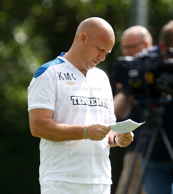 Assistant manager Kenny McDowall studies his tactics at training