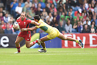 Wales's William Harries is tackled by Australia's Pama Fou<br /> <br /> Australia Vs Wales - Men's quarter-final<br /> <br /> Photographer Chris Vaughan/CameraSport<br /> <br /> 20th Commonwealth Games - Day 4 - Sunday 27th July 2014 - Rugby Sevens - Ibrox Stadium - Glasgow - UK<br /> <br /> © CameraSport - 43 Linden Ave. Countesthorpe. Leicester. England. LE8 5PG - Tel: +44 (0) 116 277 4147 - admin@camerasport.com - www.camerasport.com
