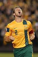 MELBOURNE, 11 JUNE 2013 - Lucas NEILL (C) of Australia celebrates his first goal for Australia after ninety one matches in a Round 4 FIFA 2014 World Cup qualifier match between Australia and Jordan at Etihad Stadium, Melbourne, Australia. Photo Sydney Low for Zumapress Inc. Please visit zumapress.com for editorial licensing. *This image is NOT FOR SALE via this web site.