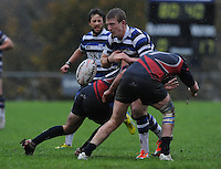 26th October 2013; Finn Gormley, Corinthians, is tackled by Dave Godfrey and Peter McCague, Blackrock. Ulster Bank League Division 1B, Blackrock College v Corinthians, Stradbrook Road, Dublin. Picture credit: Tommy Grealy / Actionshots.ie