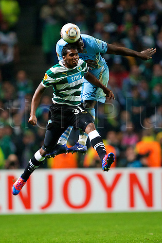 15.03.2012 Manchester, England. Manchester City's English defender Micah Richards and Sporting Clube de Portugal Brazilian midfielder Renato Neto in action during the UEFA Europa Cup match between Manchester City v Sporting at the Etihad Stadium. City won the game 3-2 on the night but lost out to away goals on aggregate and crashed out of the tournament.